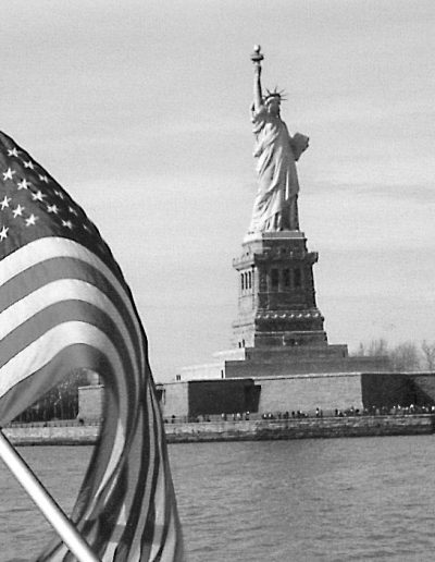 Statue of Liberty and U.S. Flag (entering New York Harbor)
